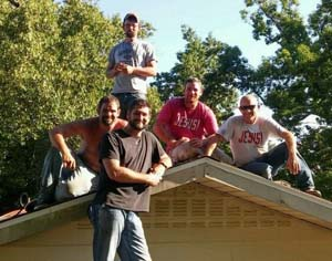 men posing on roof