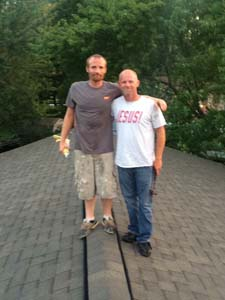 two guys standing on roof