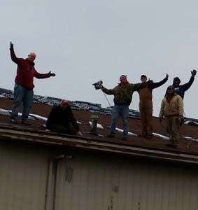 guys wave from rooftop