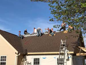 men finishing roofing job